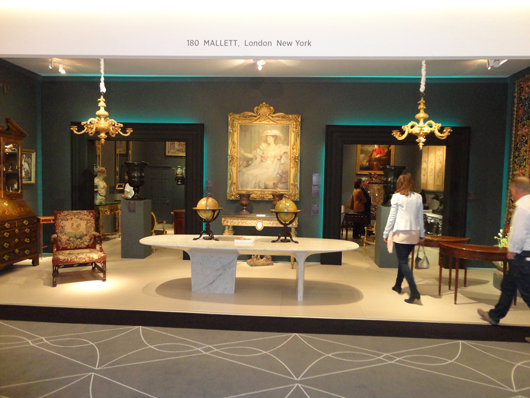The stand of London fine furniture and works of art dealers Mallett at the European Fine Art Fair. Image Auction Central News.