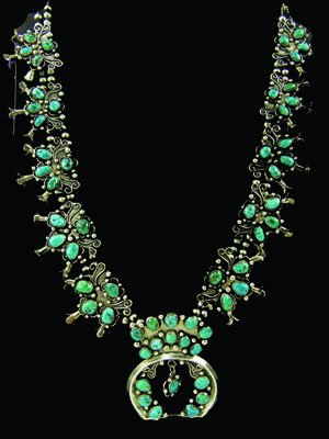Oversized turquoise and silver squash blossom Navajo necklace by Yellow Bird. Price realized: $3,163. Allard Auctions Inc. image.