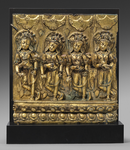 From: Oliver Forge / Brendan Lynch, a 15th century gilt bronze plaque depicting four offering goddesses, from the Tibetan Dentasil Monastery. Asia Week New York image.