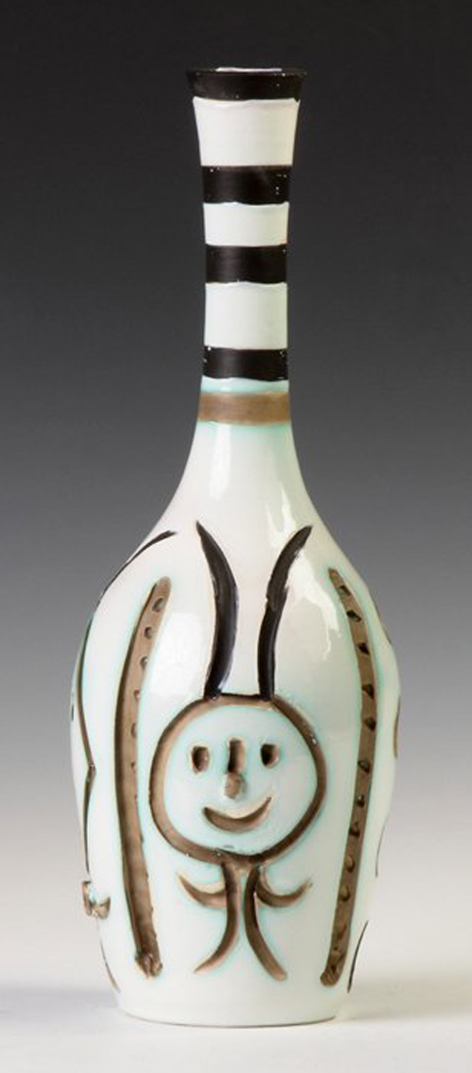 Engraved bottle, executed circa 1954 by Pablo Picasso, marked on bottom #147/300. Price realized: $14,000. Cottone Auctions image.
