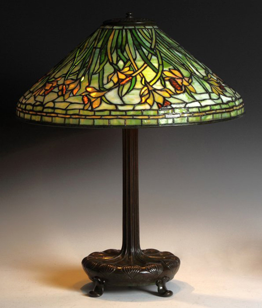 Tiffany Studios Daffodil lamp with base and shade both signed, 25 inches tall. Price realized: $57,000. Cottone Auctions image.