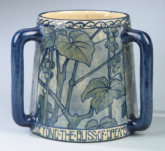 A rare form, this high-glaze handled tyg, decorated circa 1900-1901 by Amelie Roman, sold for $22,325 in 2005. The inscription reads: 'One Sip of This Will Bathe The Drooping Spirits In Delight Beyond The Bliss of Dreams.' Courtesy Neal Auction Co.