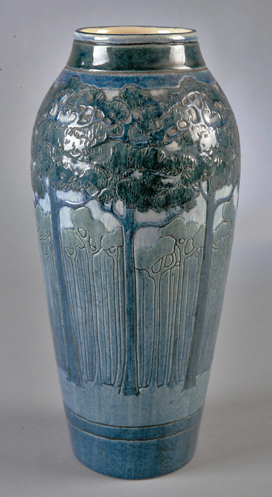 A 1908 high-glaze vase with a circle of pine trees decorated by Leona Nicholson is an excellent example of how carving and modeling was used to add depth to the painted design; this vase doubled its estimate to bring $67,000 in 2007. Courtesy Neal Auction Co.