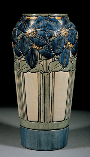 Neal Auction Co. set a world auction record for Newcomb Pottery in June 2009 when this high glaze vase, decorated in 1904 by Marie de Hoa LeBlanc with an incised design of Jackmanii Climbing Clematis, brought $169,200 after spirited bidding (est. $35,000-$50,000). Courtesy Neal Auction Co.