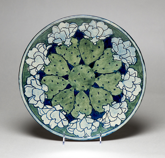From the exhibition, this rare plate was decorated with an overall cactus design around 1903 by Newcomb College student Harriet Joor. As usual, resident potter Joseph Meyer created the clay form, which was incised, painted, and finished with a glossy glaze. Newcomb Art Collection, Tulane University