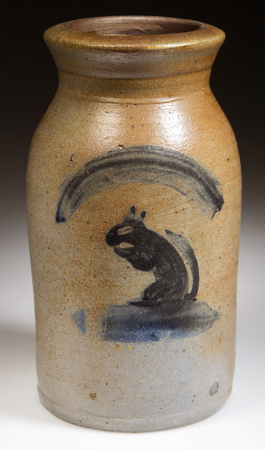 Lot 111, a salt-glazed stoneware canning jar made by Thompson Pottery in Morgantown, W.Va., sold for $48,875. The bold image of a squirrel, painted in cobalt blue on the body, had the saleroom abuzz. Jeffrey S. Evans & Associates image.