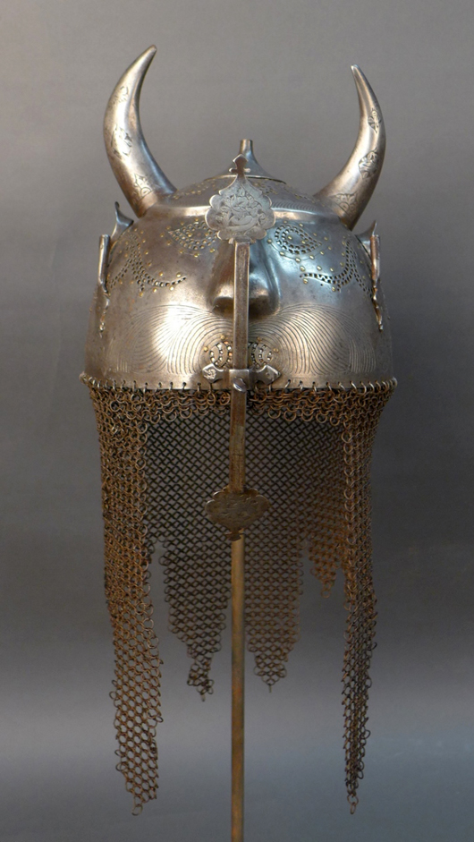 Persian devil's head Kulha Khud period helmet, circa 1750-1800. Sterling Auctions image