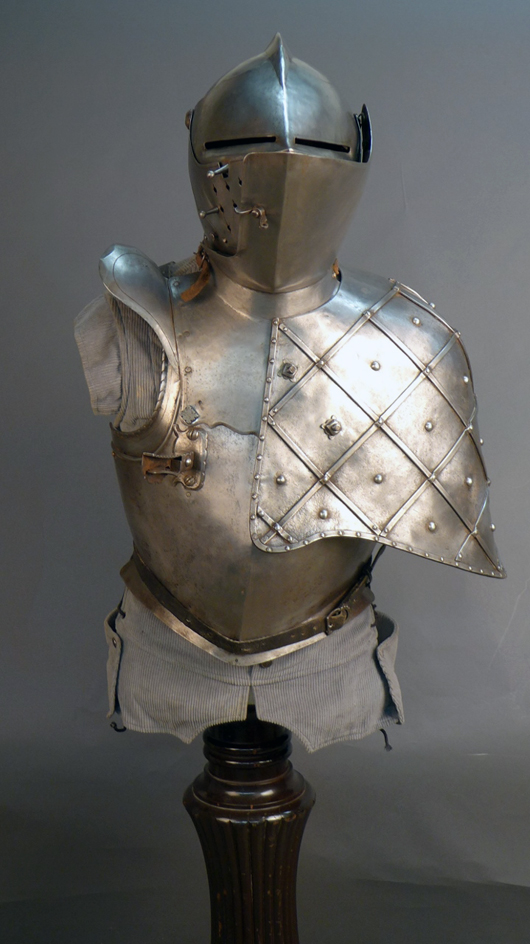 5-piece jousting suit of armor, helmet and shield circa 1580; backplate dated to 1560. Sterling Auctions image