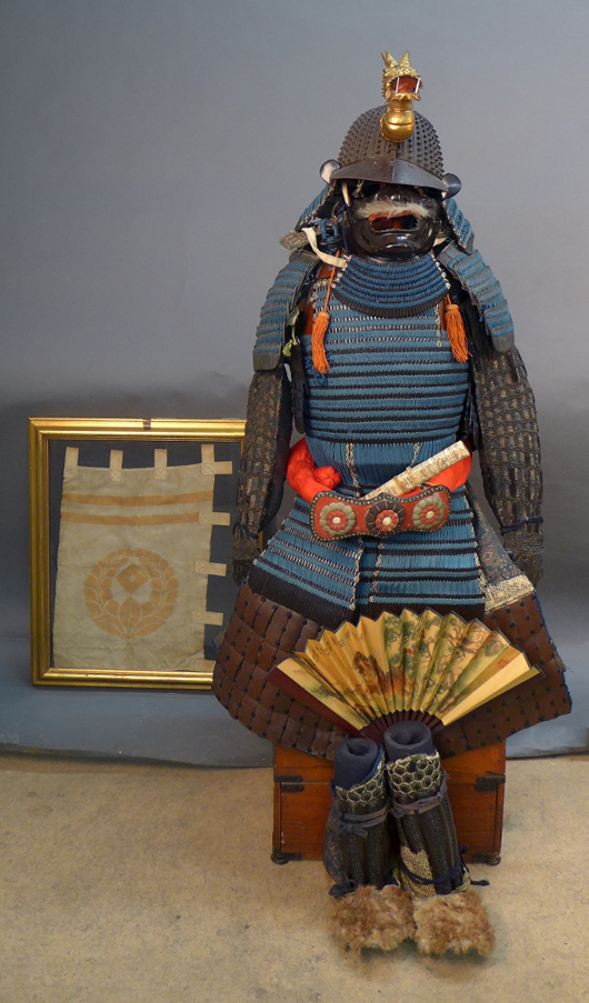 Lot comprising more than 20 pieces of Japanese Samurai armor with classic Edo-period lightweight wood storage case and framed rare Samurai Sashimono banner flag. Sterling Auctions image