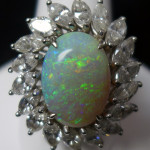 14K white gold cocktail ring with large opal and 18 marquise-cut diamonds. Sterling Auctions image