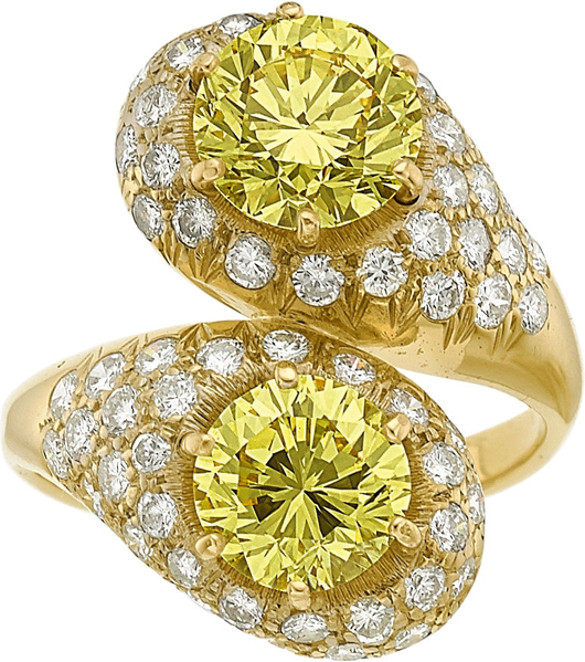 Fancy yellow diamonds gold ring, approximately 4.73 carats and enhanced by full-cut diamonds. Estimate: $60,000-$80,000. Heritage Auctions image.