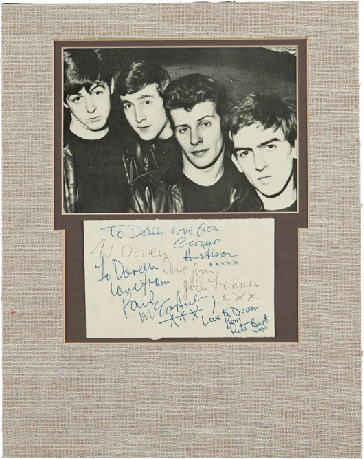 Beatles early signatures on album page with 7 x 5 early promo photo picturing Paul, John, George and original drummer Pete Best (circa 1962). Estimate: More than $10,000. Heritage Auctions image.