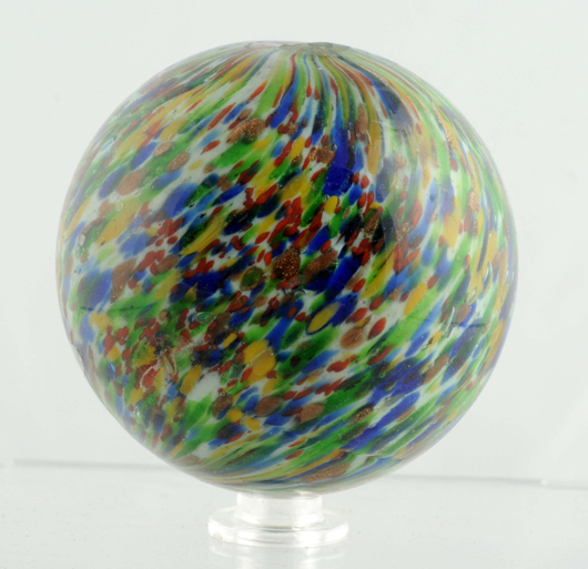Rare and large (2-7/16in) onionskin lutz marble in lime green, blue, yellow and oxblood red. Est. $6,000-$10,000. Morphy Auctions image