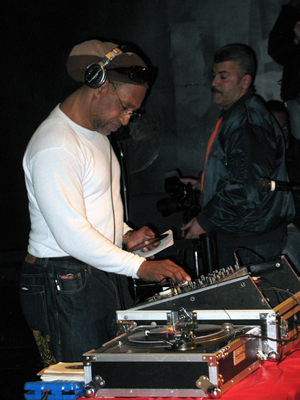 Jamaican-born DJ Kool Herc, who originated hip hop music in the early 1970s in the Bronx, New York City, promoted hard funk music as an alternative to the violent gang culture of his neighborhood. In this February 28, 2009 photo taken by Bigtimepeace, Kool Herc spins records in the Hunts Point section of the Bronx at an event addressing 'The West Indian Roots of Hip Hop.'