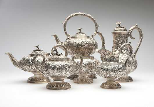 Estimated to earn $6,000-$9,000, this repousse-decorated sterling silver coffee and tea service is by Baltimore maker S. Kirk & Son. John Moran Auctioneers image.