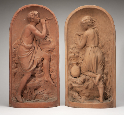 A pair of terra-cotta relief sculptures by Robert Wallace Martin (British, 1843-1923), carries an estimate of $6,000-$9,000.  John Moran Auctioneers image.