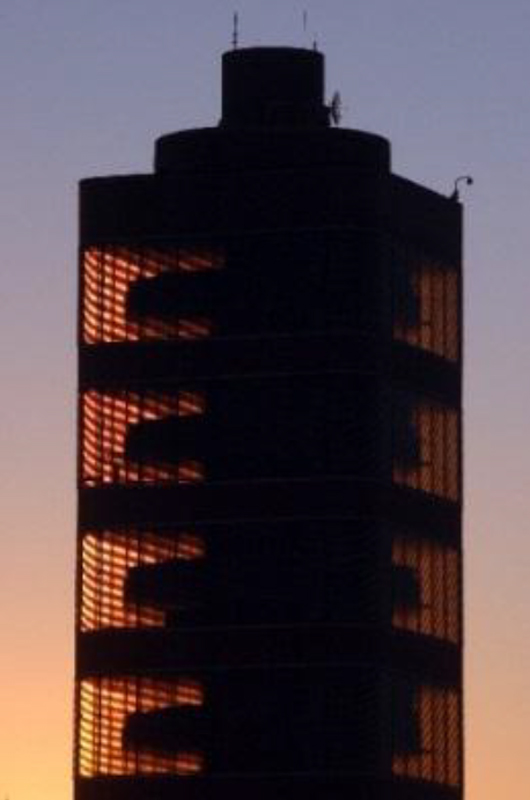 The unique taproot core design of The Tower illuminated by the sunset. The Tower is an inspiring example of cantilever construction with an inner core extending 50 feet into the ground that provides support for the 16 million pound structure. Frank Lloyd Wright coined the term 'taproot' to describe the unique foundation to his design and in keeping with his overall vision for the SC Johnson campus as a whole. Photo Credit: SC Johnson.