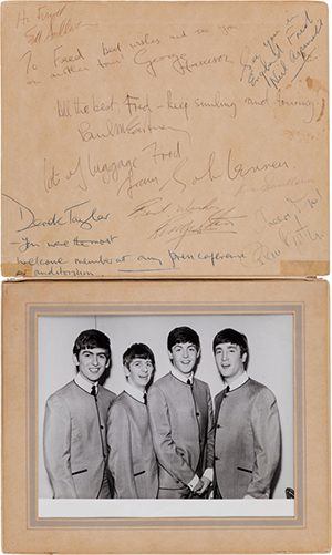 The Beatles, Ed Sullivan and Brian Epstein signatures from their first appearance on the Ed Sullivan Show, Feb. 9, 1964, an 8 x 10 glossy of the Fab Four in a foldover photo album. Price Realized: $125,000. Heritage Auctions image.