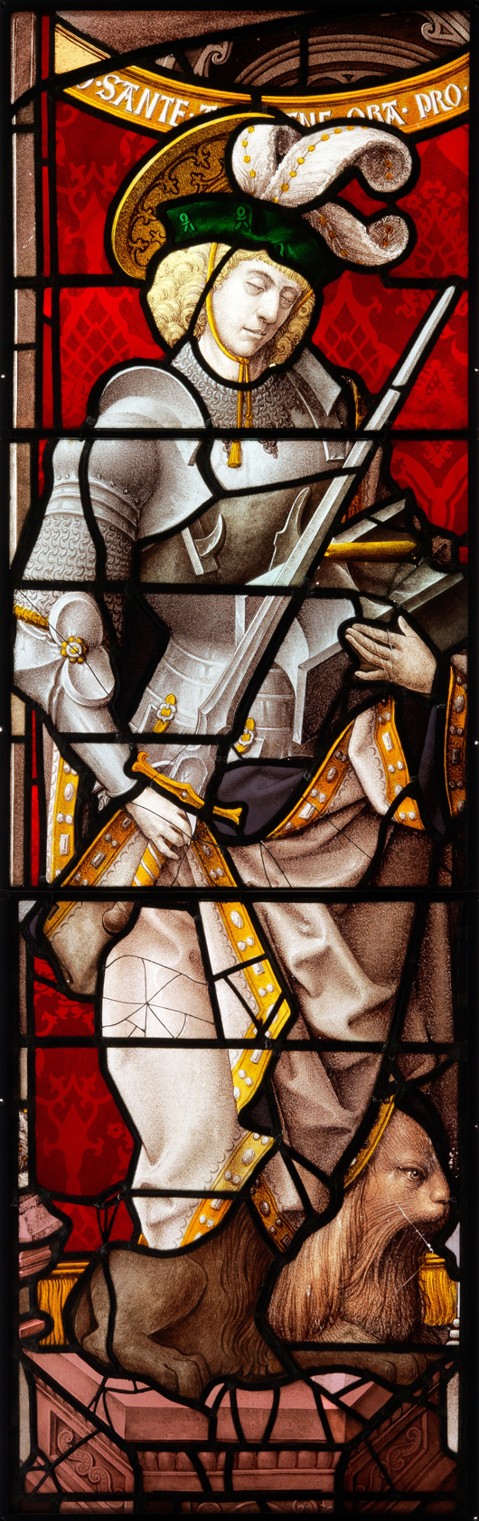 A stained glass panel of St Adrian of Nicomedia, probably Flemish or German, early 16th century and later. 186.5 x 59 cm. See Detroit Institute of Art, Accession No. 58.111 for what appears to be a companion window depicting St. Wenceslas. Est. £1,000-£2,000. Thomas Del Mar image