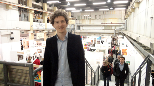 Ryan Stanier, founder-director of The Other Art Fair at his Marylebone event in April. Image Auction Central News.