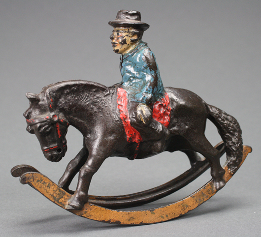 An extremely rare and desirable semi-mechanical Circuit Rider is one of the most highly prized banks in the Moore Collection. RSL Auction Co. image