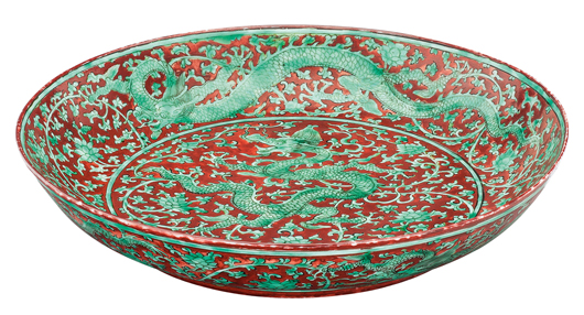 This iron red and green Dragon Plate is a highlight of Auktionshaus Kaupp's Asian portion of the sale. The plate from the Zhenghde Period depicts a five-clawed dragon, meaning it was reserved for use only by the Emperor and his highest-ranking officers. Photo courtesy Auktionshaus Kaupp.