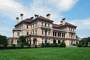 The most famous structure within Bellevue Avenue's National Historic Landmark District in Newport is The Breakers, the summer home of Cornelius Vanderbilt II, located in Newport, Rhode Island, United States. It was built in 1893, added to the National Register of Historic Places in 1971, and designated a National Historic Landmark in 1994. Photo by Matt H. Wade, a k a UpstateNYer, and is licensed under the Creative Commons Attribution-Share Alike 3.0 Unported license.