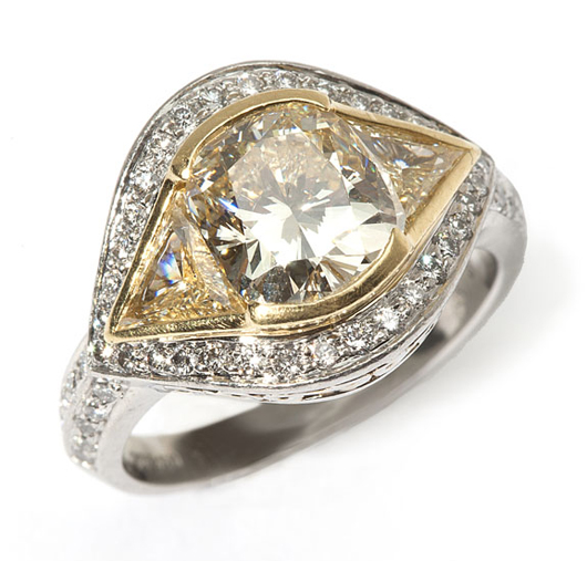 A platinum and yellow cushion-cut diamond ring, 2.85 carats, with brilliant-cut yellow diamond shoulders, has been assigned an estimate of $12,000 - $15,000. John Moran Auctioneers image.