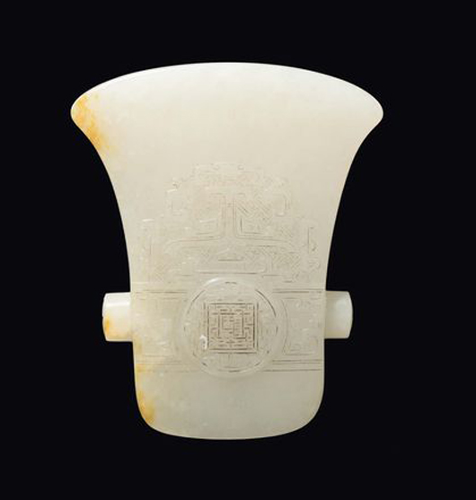 An extraordinary imperial white jade plate engraved on two sides with taotie figures and archaic elements, China, relief mark and the period Qianlong (1736-1796), 7.3x6 cm. Estimate: €20,000-30,000. Courtesy Cambi, Genoa.