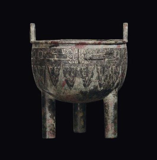 A small bronze ritual tripod censer, China, Shang Dynasty (1750-1028 B.C.), 16.5 cm high, provenance: Tucci collection - Rome and Giuganini collection. Estimate: €30,000-40,000. Courtesy Cambi, Genoa.