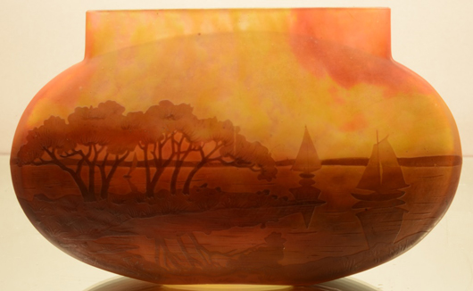 Signed Daum Nancy French cameo art glass vase depicting lake and sailboats at sunset, 4 1/2 inches high, circa 1920. Estimate: $1,800-$3,200. Bruhns Auction Gallery image.