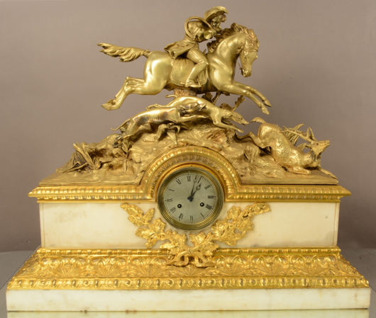 French Louis XIV figural bronze mantel clock, silk string French movement, 22 inches by 26 inches by 8 inches, circa 1850. Estimate: $1,800-$3,200. Bruhns Auction Gallery image.