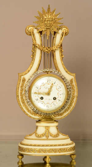 Tiffany Louis XIV bronze and marble clock, porcelain dial signed Tiffany & Co. New York, Paris, time and bell strike, works signed Tiffany, 30-day movement, circa 1880, 18 inches high. Estimate: $3,800-$5,500. Bruhns Auction Gallery image.