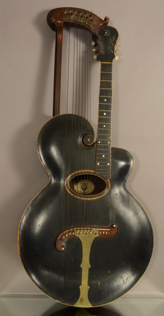 Gibson guitar original label #6191, 47 inches, circa 1905. Estimate: $500-$4,500. Bruhns Auction Gallery image.