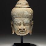 Khmer carved stone Buddha head, circa 12th-14th century. Estimate: $1,000-$1,500. Artemis Gallery Live image.
