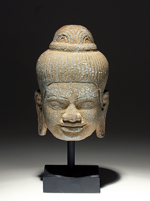 Khmer carved stone Buddha head, circa 12th-14th century. Estimate: $1,000-$1,500. Artemis Gallery Live image.