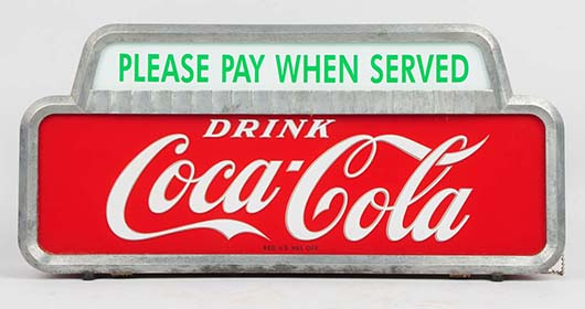 1950s Coca-Cola illuminating countertop sign, 19in long. Est. $800-$1,200. Morphy Auctions image