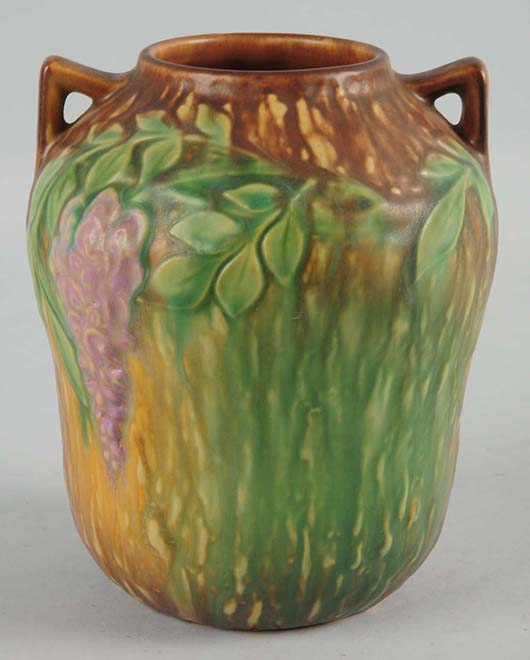 Roseville Wisteria pottery vase, 7in tall, retains original paper label. Est. $300-$500. Morphy Auctions image