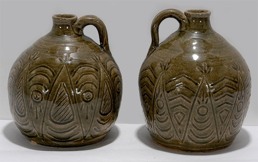 Pair of Indian motif whiskey jugs by Cheever Meaders, circa 1960s, done in an ash glaze, 8 1/2 inches tall. Price realized: $13,200. Slotin Folk Art Auction image.