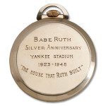 The inscription on the back of the pocket watch commemorating the 25th anniversary of the opening of Yankee Stadium in the Bronx. Image courtesy of SCP Auctions.