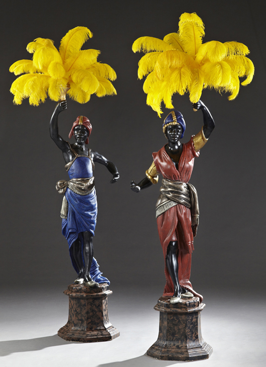 Pair of early 20th century parcel gilt polychrome carved wood blackamoor torcheres on marble stepped bases, both 80 inches tall. Estimate: $4,000-$6,000. Crescent City Auction Gallery image.