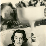 Photographer: W. Vennemann. Salvador Dali in front of his painting 'Apparition of Face and Fruit Dish on a Beach' (1938/39). Image courtesy of LiveAuctioneers.com Archive and Bassenge, Berlin.