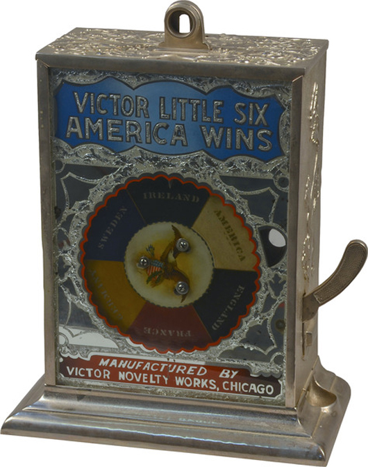 This Victor Novelty Works five-cent cast-iron tabletop gambling machine, circa 1907, topped $32,000. Victorian Casino Antiques image.