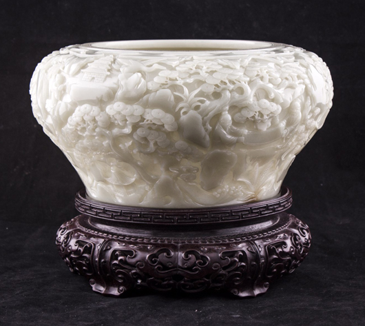 Lustrous white jade brush washer with Qianlong seal mark on a zitan stand, 10 inches diameter. Estimate: $30,000-$45,000. Linwoods Auctions image.