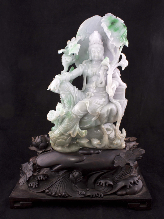 An elaborately carved Guanyin jadeite statue, 21 inches tall. Estimate: $30,000-$45,000. Linwoods Auctions image.