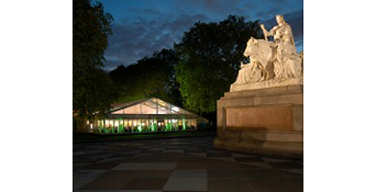 The Art Antiques London pavilion in Kensington Gardens can be an inviting prospect on summer evenings. Image courtesy Art Antiques London.