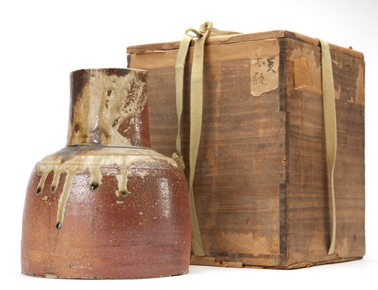 This deceptively simple, unglazed Bizen ware pottery vase by renowned Japanese artist by Kitaoji Rosanjin (1883-1959) is expected to fetch $4,000-$6,000. John Moran Auctioneers image.