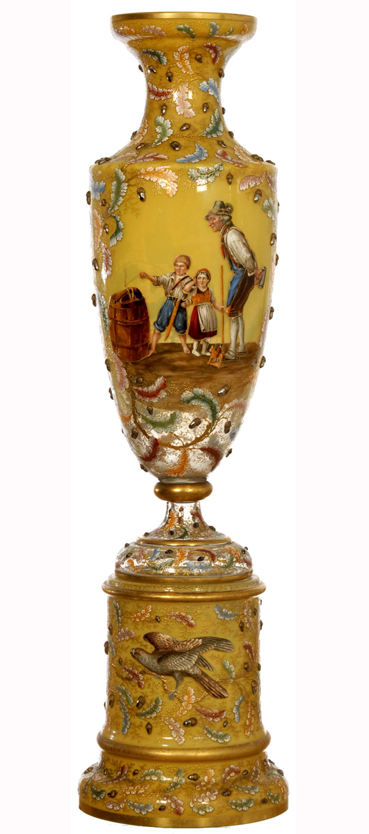 Signed Moser two-part pedestal vase with yellow opaque background and leaf and applied acorn décor. Price realized: $38,000. Woody Auction image.