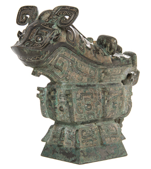 Chinese bronze ritual gong vessel having a fitted cover depicting a horned beast. Price realized: $722,500. Leslie Hindman Auctioneers image.