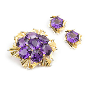 This assembled set of amethyst and 18K gold jewelry – the brooch by Jean Schlumberger' and the ear clips by David Webb – went home with a floor bidder for $19,200 (estimate: $8,000-$1,200). John Moran Auctioneers image.